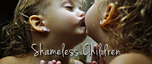 little girl kissing mirror