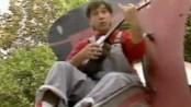 creepy dude singing on a slide