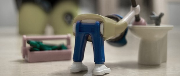 a toy plumber bending over