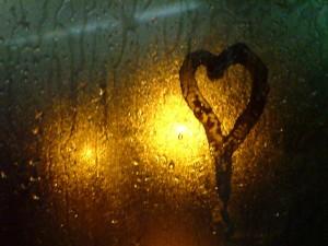 heart shape on wet window