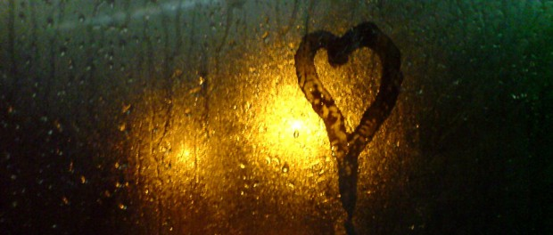 heart shape on wet window